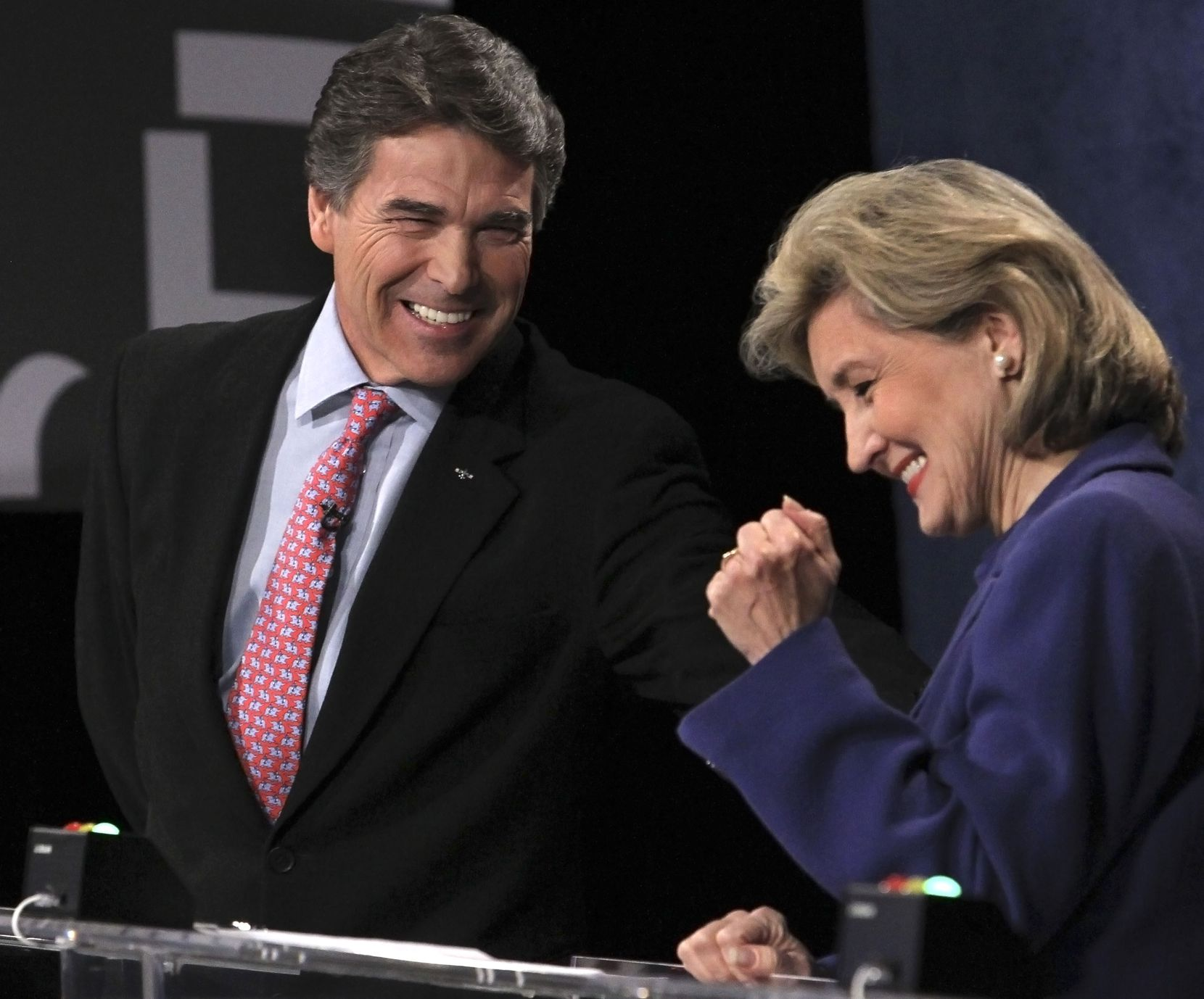 Texas Gov. Rick Perry and Sen. Kay Bailey Hutchison, R-Texas, shared a light moment during their 2010 GOP gubernatorial debate in Dallas.