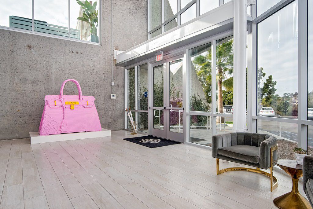A giant pink Hermes Birkin bag sits in the lobby of Fashionphile's headquarters in Carlsbad, Calif.