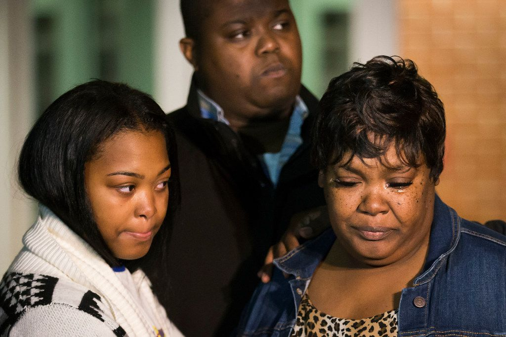 Jacqueline Craig (right) attended a news conference with her 15-year old daughter and cousin Rod Smith outside the Fort Worth Police Department on Dec. 22. (Smiley N. Pool/Staff Photographer)