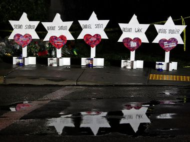 Stars of David with names of those killed at the Tree of Life Synagogue in Pittsburgh are part of a memorial outside the synagogue.