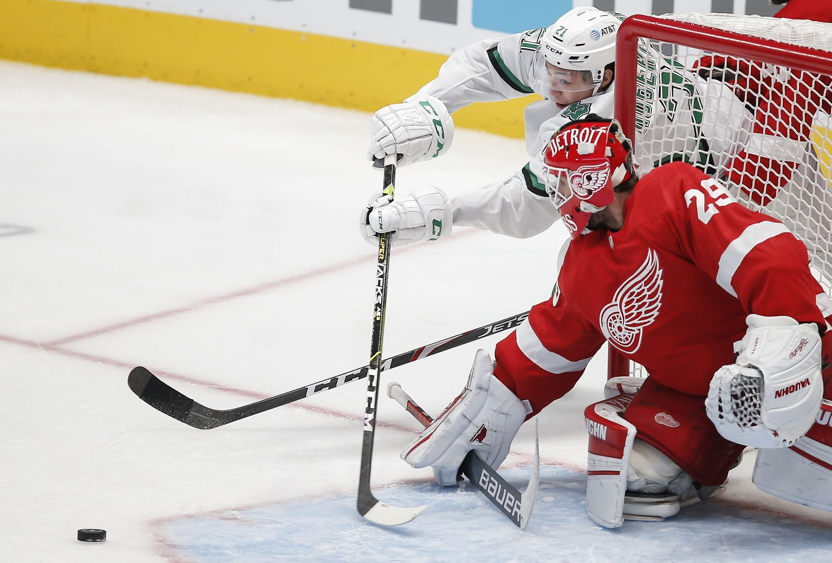 Dallas Stars forward Jason Robertson (21) attempts a wrap-around shot as Detroit Red Wings goaltender Thomas Greiss (29) defends during the third period of an NHL hockey game in Dallas, Monday, April 19, 2021. Dallas won 3-2 in a shootout. (Brandon Wade/Special Contributor)