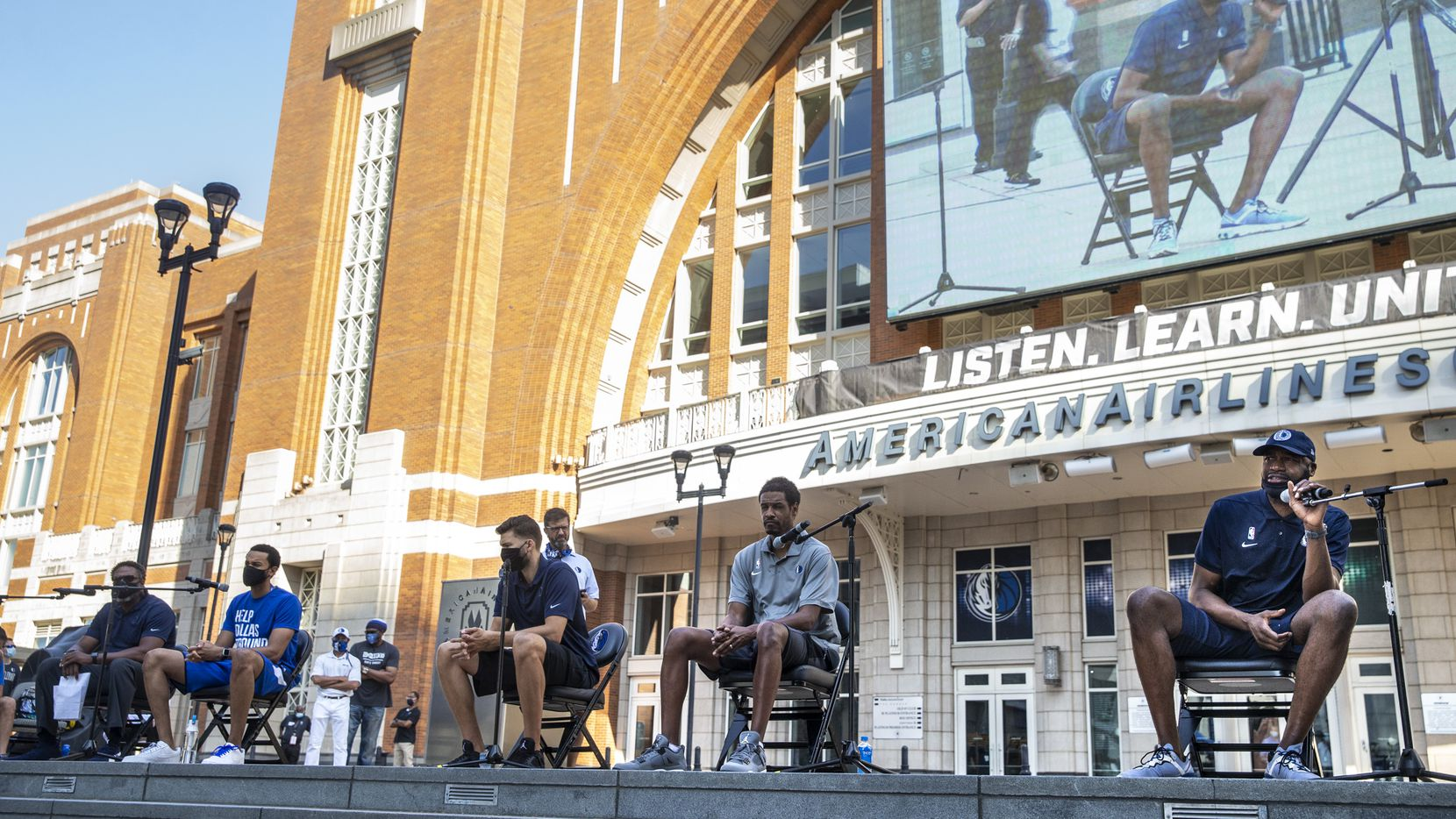 From right, panelists Cedric Ceballos, assistant coach Stephen Siles, forward Maxi Kleber, Sekou Lewis and assistant Jamahl Mosley speak during a ÒCourageous ConversationsÓ meet-up to discuss systemic racism at Victory Plaza outside the American Airlines Center  in Dallas on Tuesday, June 9, 2020. Dallas Mavericks CEO Cynt Marshall hosted the event with all team employees, including players and coaches, to discuss systemic racism and disparities facing the African-American community.