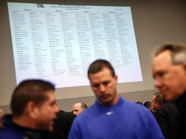 Dallas-area football coaches and athletic directors gathered to view the new UIL realignment was announced at Birdville Fine Arts/Athletic Complex in North Richland Hills, Monday, February 3, 2014. (Tom Fox/The Dallas Morning News)