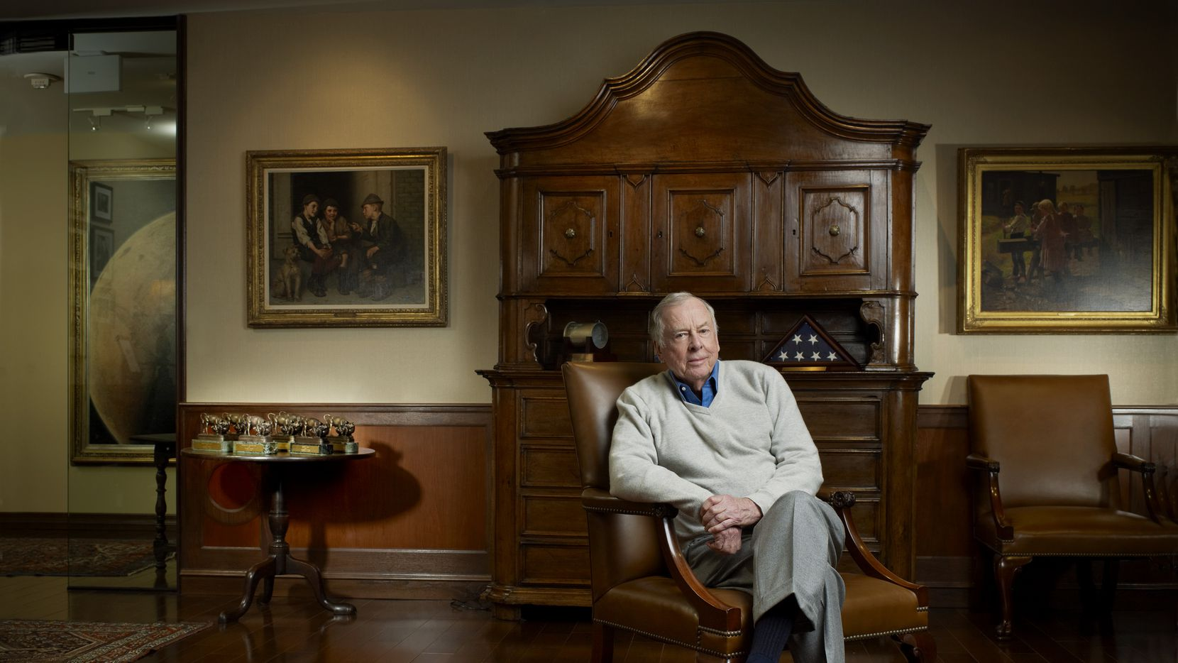 T. Boone Pickens was photographed in front of two paintings by John George Brown that will be auctioned by Christie's in New York on Oct. 28. Christie's expects Plotting Mischief, left, and Industrious Family, right, to fetch between $120,000 to $160,000 each.
