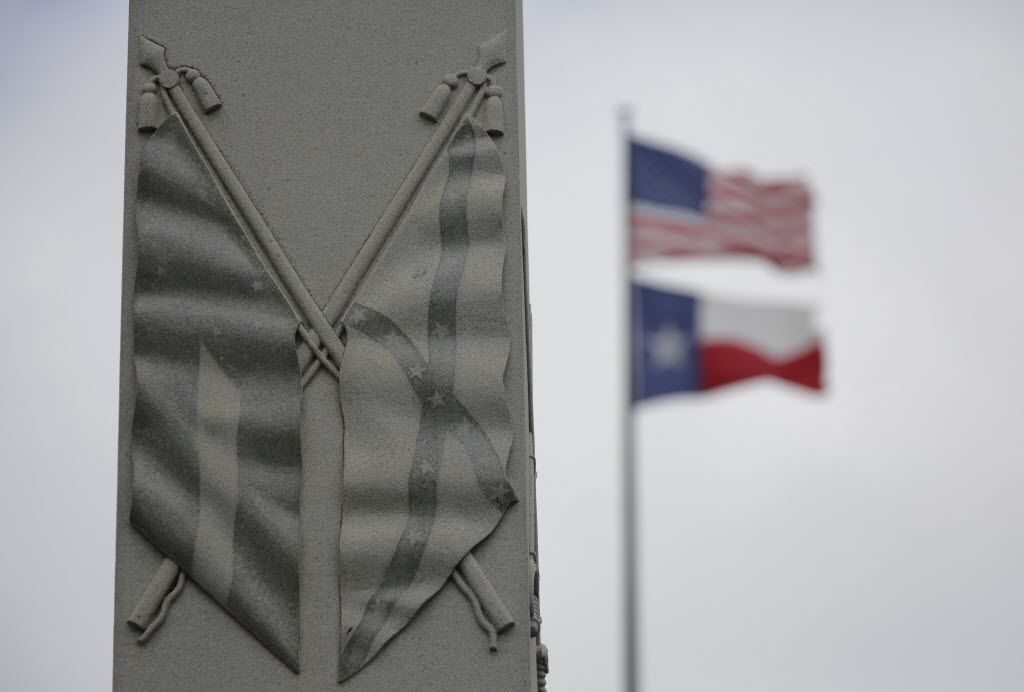 The Confederate flag is seen on a monument to Hood's Texas Brigade at the Texas State Capitol, Thursday, June 18, 2015, in Austin, Texas. The Supreme Court on Thursday upheld Texas' refusal to issue a license plate bearing the Confederate battle flag, rejecting a free-speech challenge. (AP Photo/Eric Gay)