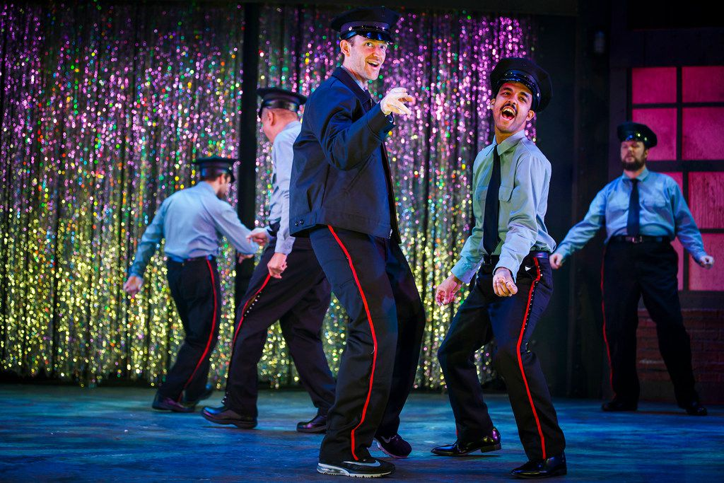 Michael Issac (left) and Aaron Green perform during dress rehearsal of the final scene of the Uptown Players production of The Full Monty  at the Kalita Humphreys Theater in Dallas.
