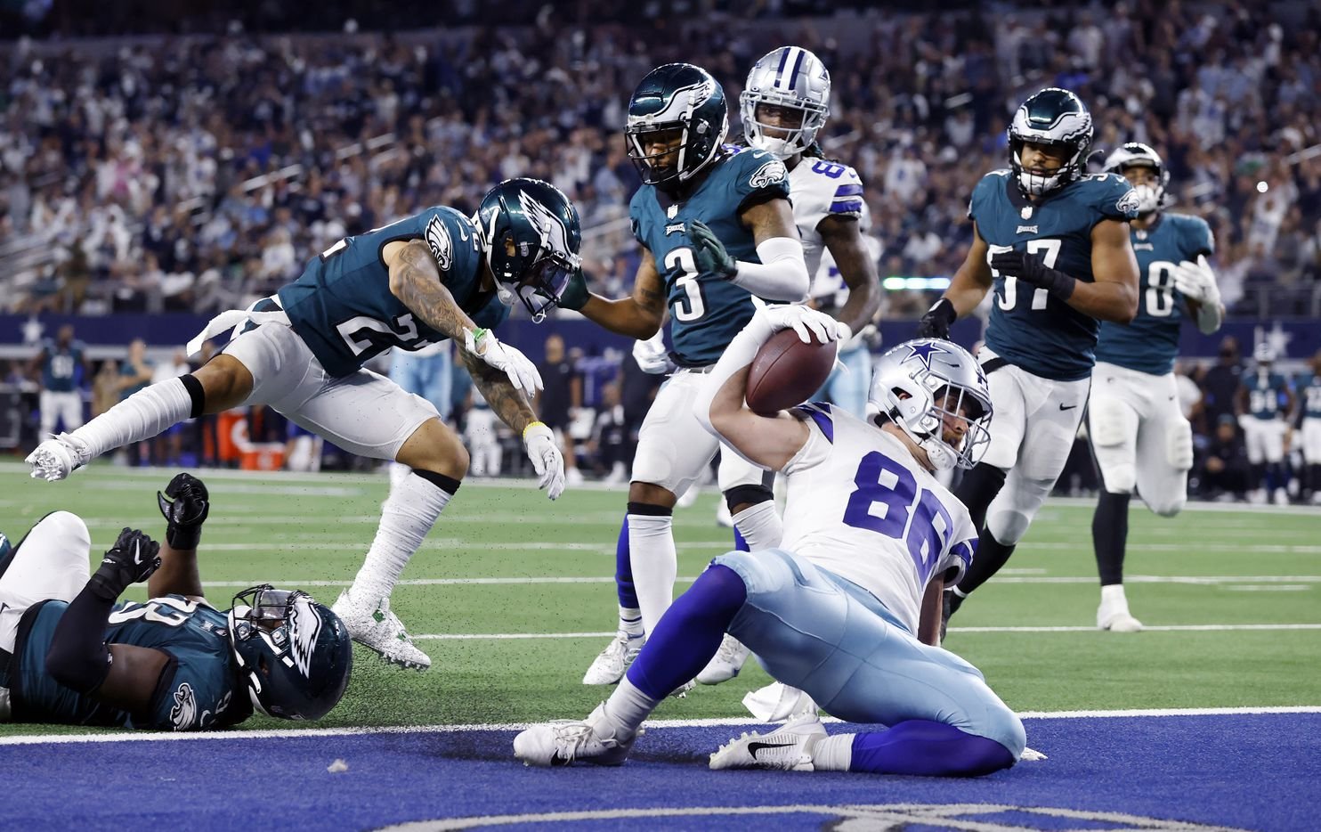 Dallas Cowboys tight end Dalton Schultz (86) slides into the end zone after running in a fourth quarter completion against the Philadelphia Eagles defense at AT&T Stadium in Arlington, Monday, September 27, 2021. (Tom Fox/The Dallas Morning News)