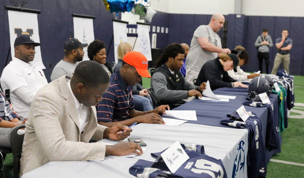 Frisco Lone Star High School football players sign their letters of intent, as family members watch, from left, Ray Onyango, Oklahoma Baptist University, MJ Rivers, University of Illinois, Nick Bolton, University of Missouri, Noah Velicer, Oklahoma Baptist University, Duce Pittman, Southwestern Oklahoma State University, and Jacob Click on national signing day in Frisco, Texas, Wednesday, February 7, 2018. (David Woo/The Dallas Morning News)
