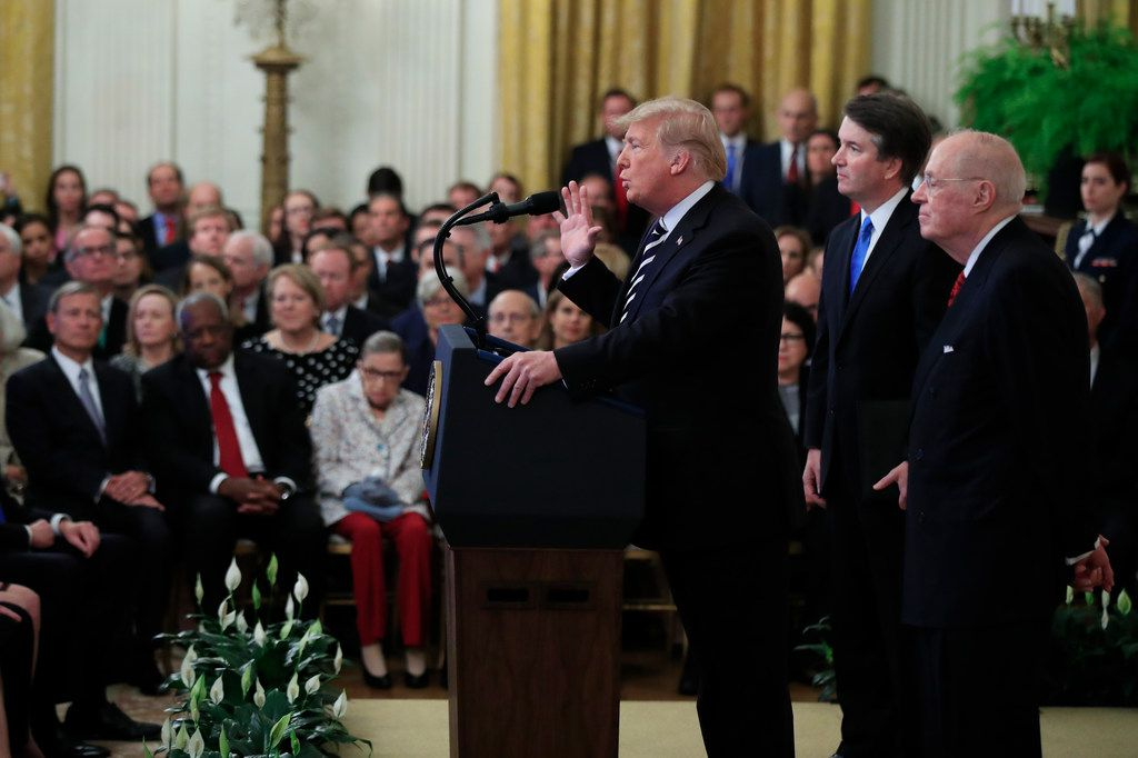President Donald Trump, with Justice Brett Kavanaugh and retired Justice Anthony Kennedy, speaks during the ceremonial swearing-in ceremony of Kavanaugh as associate justice of the U.S. Supreme Court.