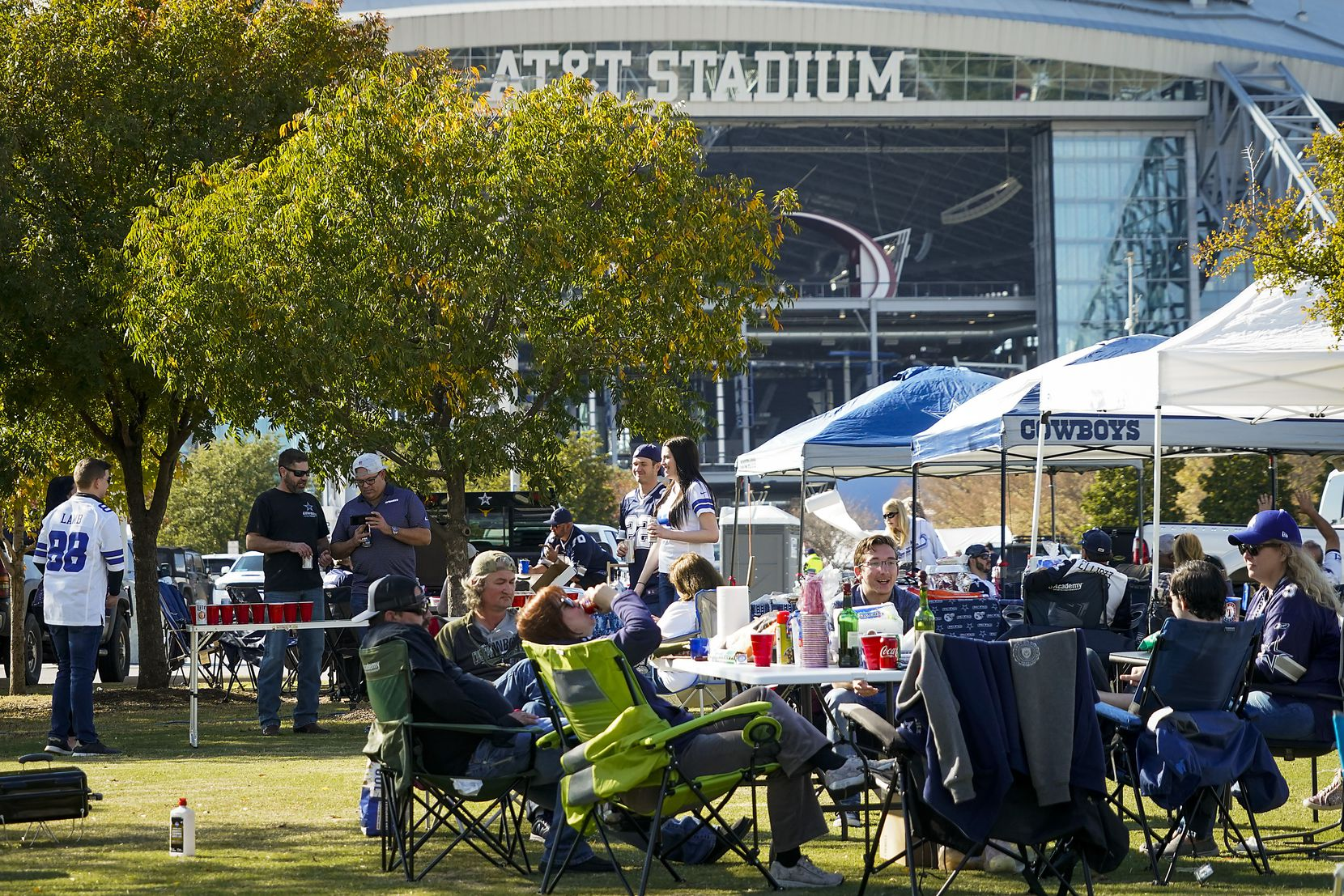 Fans tailgate before an NFL football game between the Dallas Cowboys and the Washington Football Team at AT&T Stadium on Thursday, Nov. 26, 2020, in Arlington. (Smiley N. Pool/The Dallas Morning News)