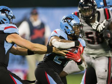 Dallas Renegades quarterback Philip Nelson (9) hands off the ball to running back Austin Walter (27) during the fourth quarter of an XFL game between the Dallas Renegades and the New York Guardians on Saturday, March 7, 2020 at Globe Life Park in Arlington.