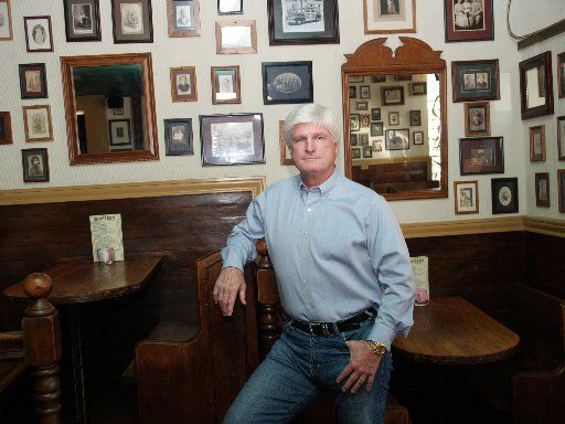 Pat Snuffer, former owner of Snuffer's Restaurant, was photographed in the 'haunted' front room of the 3526 Greenville Ave. location before it was rebuilt.