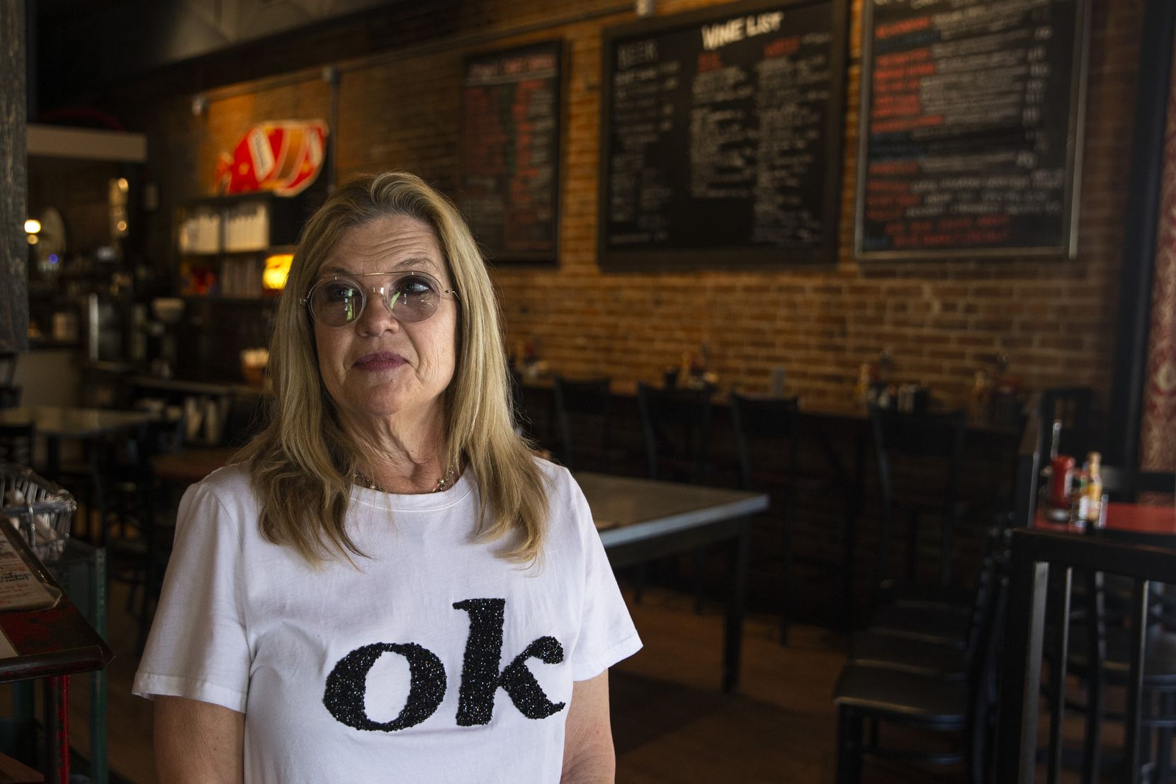 Spoons Cafe owner Karen Klassen said the pandemic has taken such a toll on business that she was often finding herself in tears at the end of the workday. Her T-shirt is a reminder to herself: Ultimately, she's trying to believe, things will be all right.