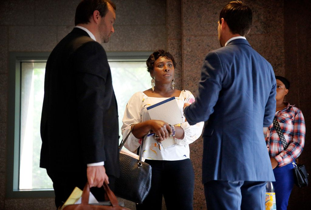 Linda Badawo (center) mother of D'ashon Morris, and her attorneys Bradley Reeves (right) and Casey Low talked outside the 3rd District Court of Appeals  in Austin on Wednesday, May 22, 2019.