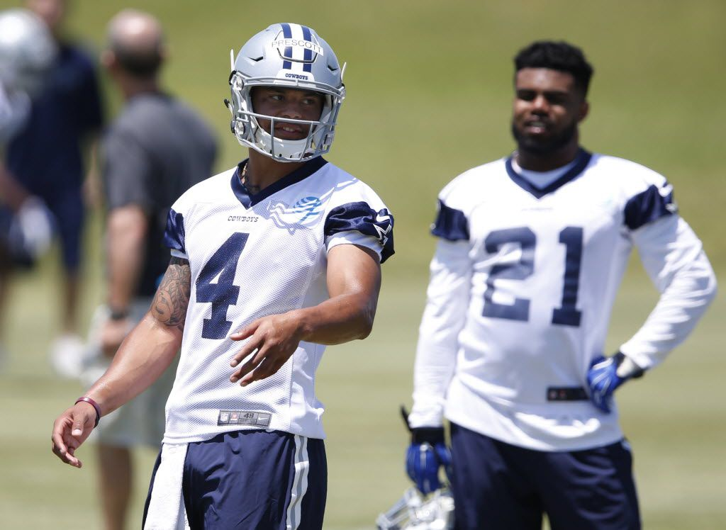 Dallas Cowboys quarterback Dak Prescott (4) walks up to the line of scrimmage in a drill as Dallas Cowboys Ezekiel Elliott (21) looks on during rookie minicamp at the Dallas Cowboys headquarters at Valley Ranch in Irving on Saturday, May 7, 2016. (Vernon Bryant/The Dallas Morning News)