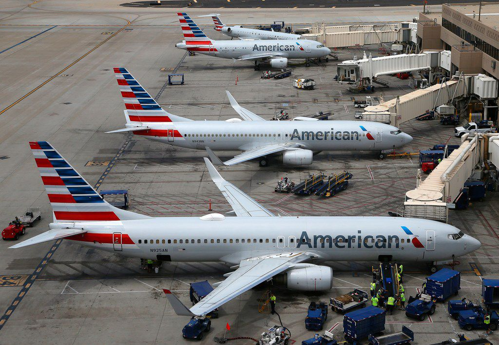 This Wednesday, July 17, 2019, photo shows American Airlines planes at Phoenix Sky Harbor International Airport in Phoenix.
