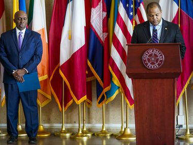 Dallas City Manager T.C. Broadnax (left, in this photo from 2020) was among officials told months ago about the errant loss of Dallas police data files, while Dallas Mayor Eric Johnson (right) only learned of the deletions this week.