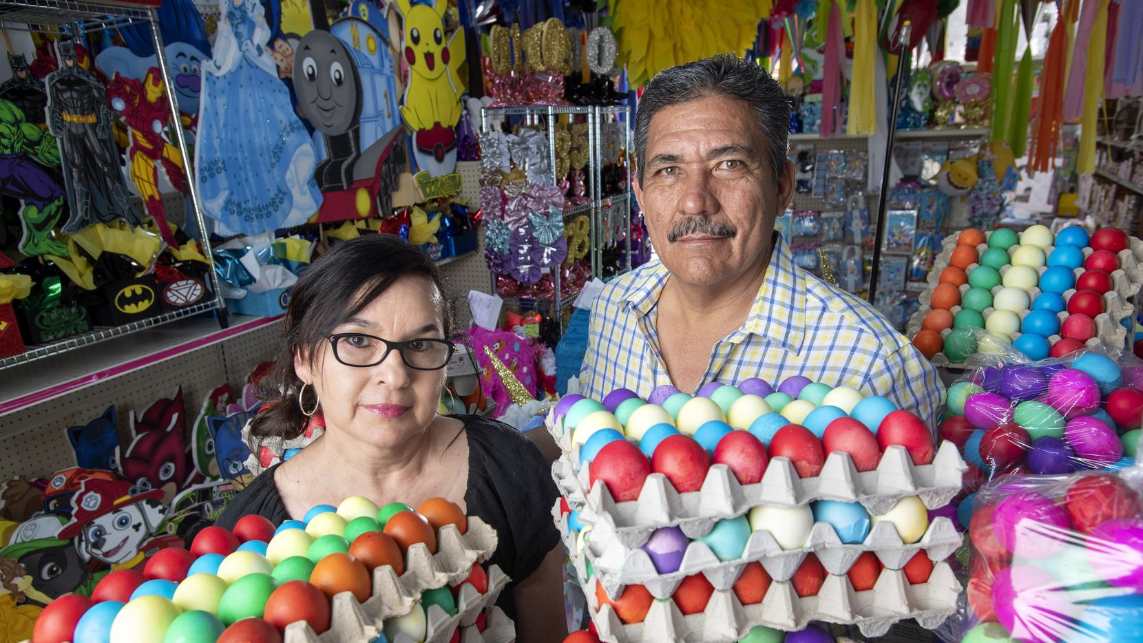 Elvie and Carlos De La Fuente, owners of ABC Party on West Davis Street in North Oak Cliff, with some of the thousands of cascarones, confetti eggs, that they contracted for and now will not be able to sell because of the coronavirus pandemic.  The couple has been in the party store business for 28 year and are anxious to reopen as soon as possible.