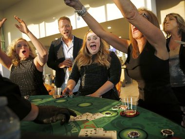 This year's No. 1 small company is Monument Realty, a first-time winner. In August, Monument Realty agents (from left) Amy Holt, owner Eddie Burns, Kristi Drayovitch and Brenda Sukenik celebrated a winning blackjack hand at a casino night at Twelve Cowboys Way in Frisco.
