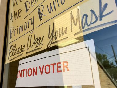 Voters were instructed to please wear their masks at a Democratic primary polling place during the state's first election during the COVID-19 pandemic.