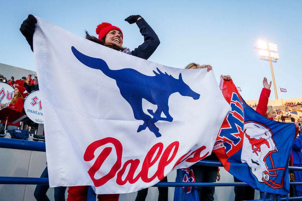 Kristen Redding, mother of SMU tight end Ben Redding, cheers as the Mustangs take the field to warm up for an NCAA football game against Memphis at Liberty Bowl Memorial Stadium on Saturday, Nov. 2, 2019, in Memphis, Tenn. (Smiley N. Pool/The Dallas Morning News)