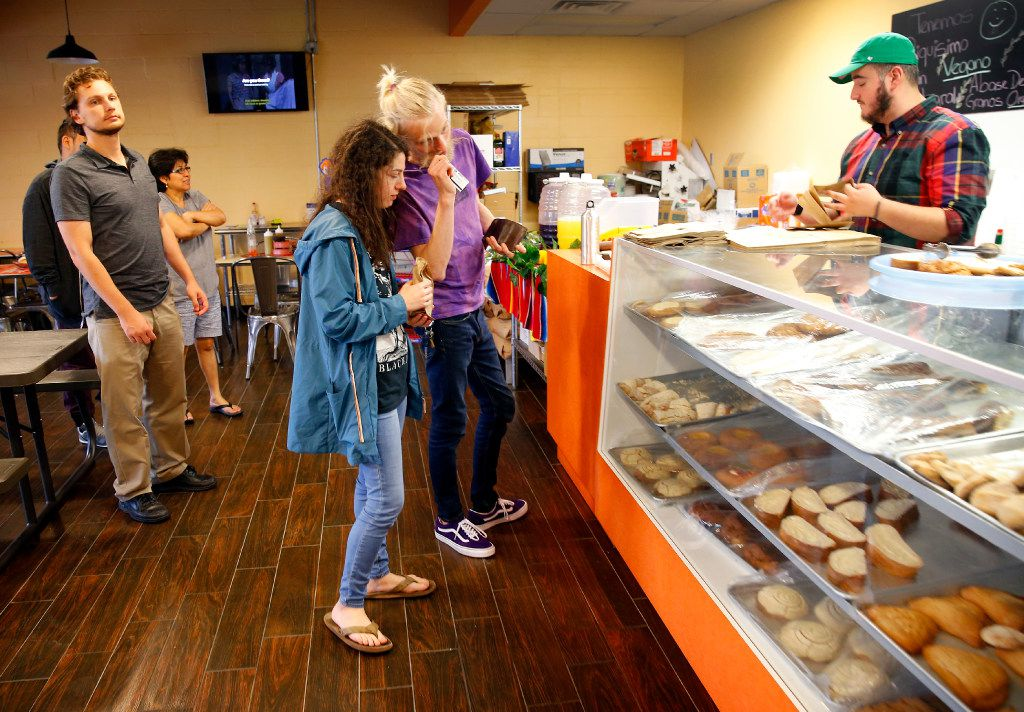 Friends Evan Gordon (center, right) and Zoe Pesce of Dallas pick out pastries.