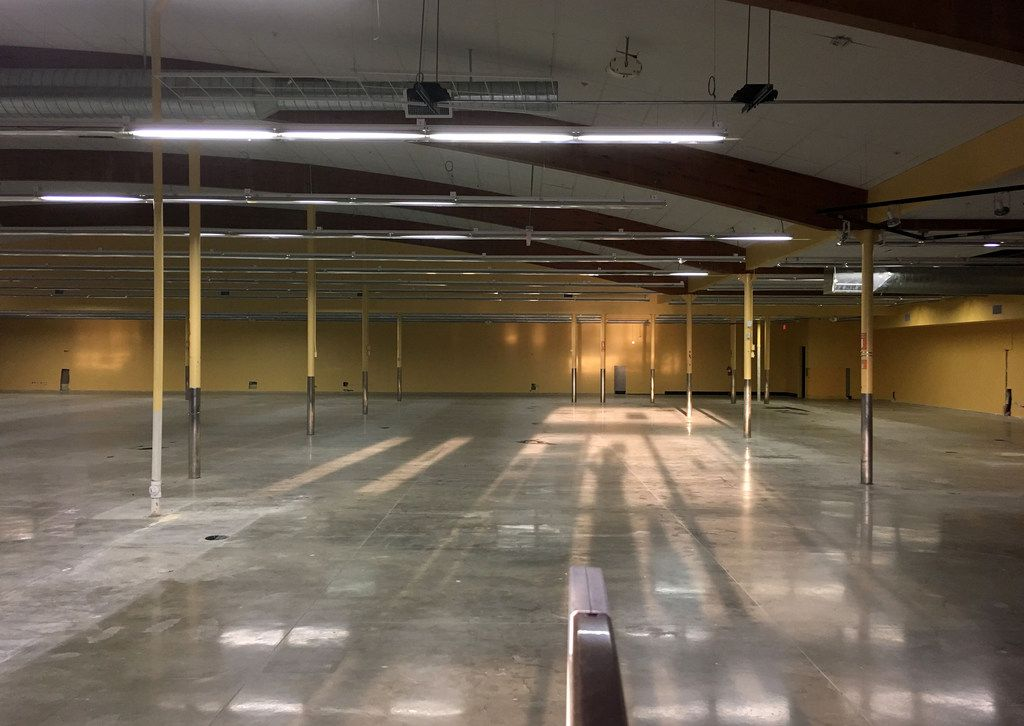 The lights were on though nobody was home at the former WalMart at Greenville and Belmont avenues on Monday.