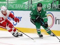 Dallas Stars defenseman Esa Lindell (23) makes his way around the goal as Detroit Red Wings center Vladislav Namestnikov (92) chases after him during the second period of play at American Airlines Center on Tuesday, January 26, 2021in Dallas.