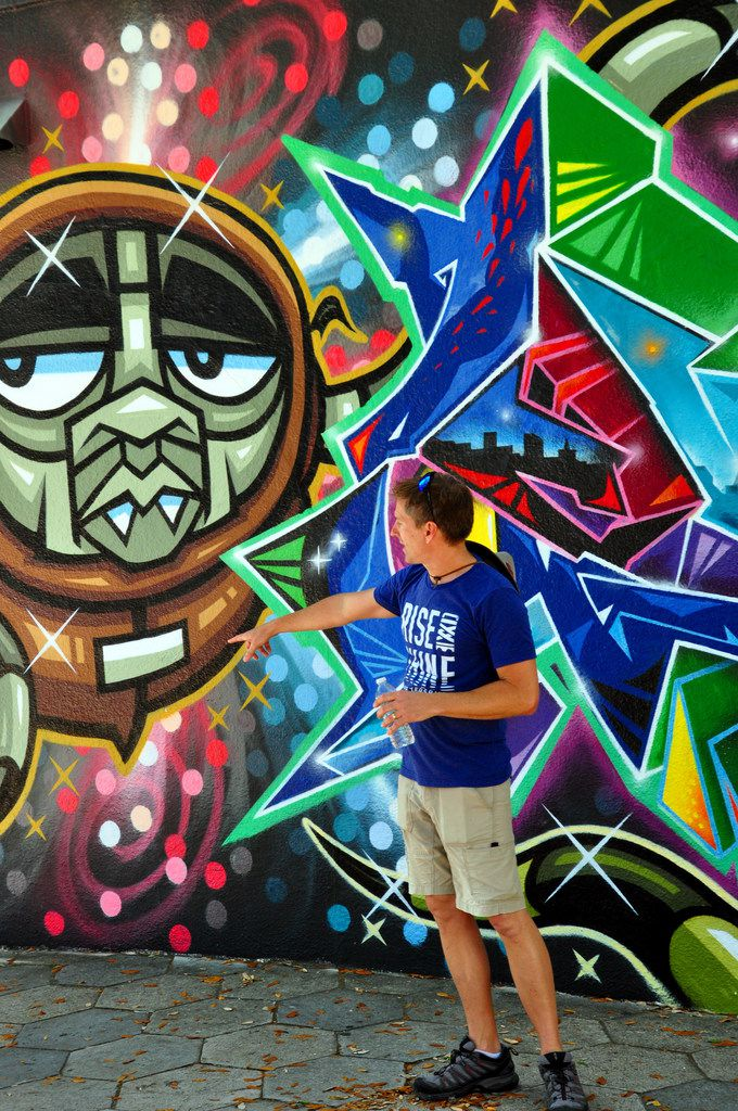 Greg Stanek talks about urban artwork during a Saturday-morning tour of murals in St. Petersburg, Fla.