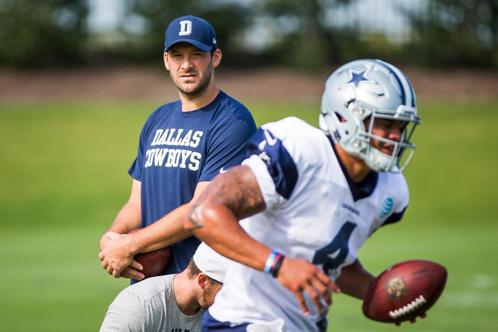 Dallas Cowboys quarterback Tony Romo watches quarterback Dak Prescott (4) on the field during the team's practice at The Star on Wednesday, Oct. 26, 2016, in Frisco. (Smiley N. Pool/The Dallas Morning News)