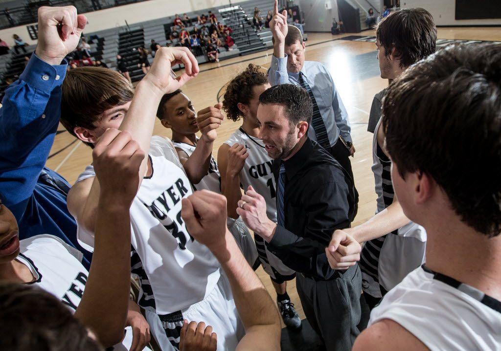 Guyer head basketball coach Grant Long talks to his team during a timeout against Keller Central Tuesday, Jan. 6, 2015, at Guyer High School in Denton, TX. Matt Garnett/Special Contributor