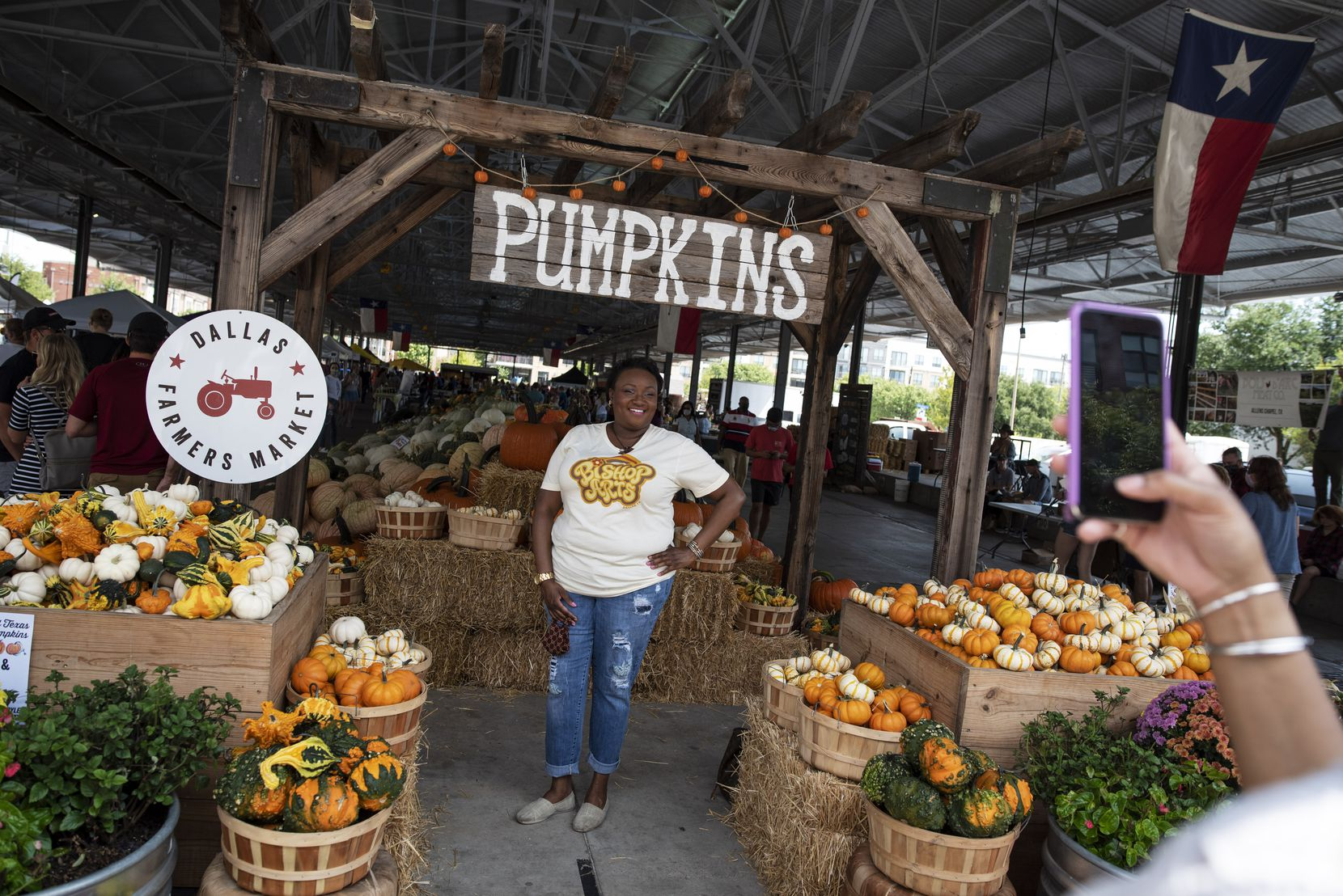 Monique Brumsey poses for a photo with pumpkins at the Dallas Pumpkin Patch during the Dallas Farmers Market in downtown, Saturday, Sept. 12, 2020. The popular pumpkin patch hosts over 25 pumpkin varieties. Ben Torres/Special Contributor