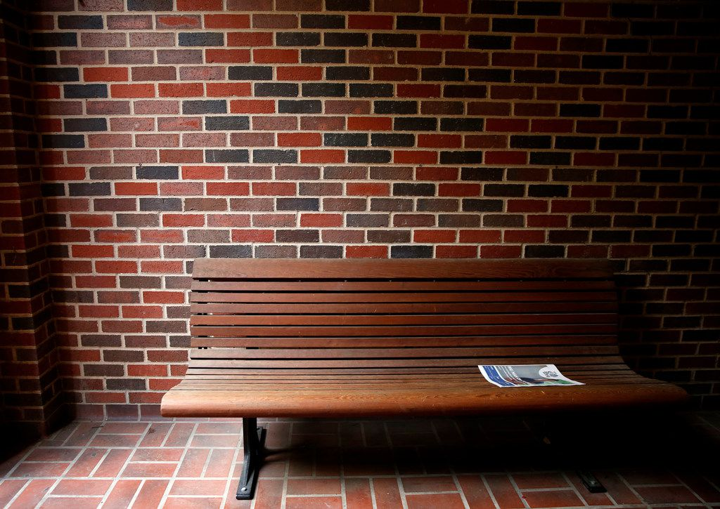 An issue of the SMU Campus Weekly, produced by The Daily Campus, is left on a bench outside the journalism complex at the Umphrey Lee Center at SMU in Dallas on Monday, May 14, 2018.