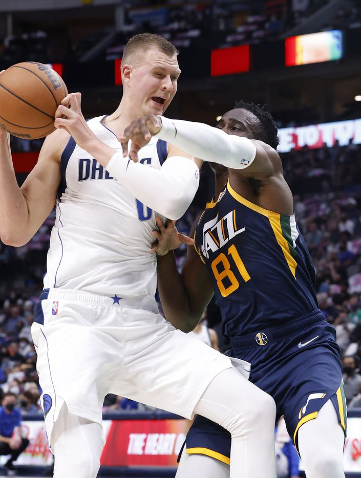 Dallas Mavericks center Kristaps Porzingis (6) has the ball knocked away by Utah Jazz guard Miye Oni (81) during the first half at the American Airlines Center in Dallas, Wednesday, October 6, 2021.(Tom Fox/The Dallas Morning News)