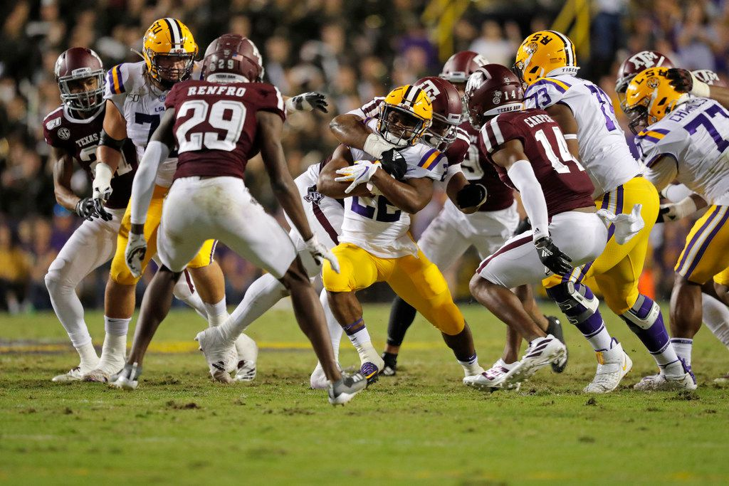 LSU running back Clyde Edwards-Helaire (22) carriers in the first half of an NCAA college football game against Texas A&M in Baton Rouge, La., Saturday, Nov. 30, 2019. (AP Photo/Gerald Herbert)