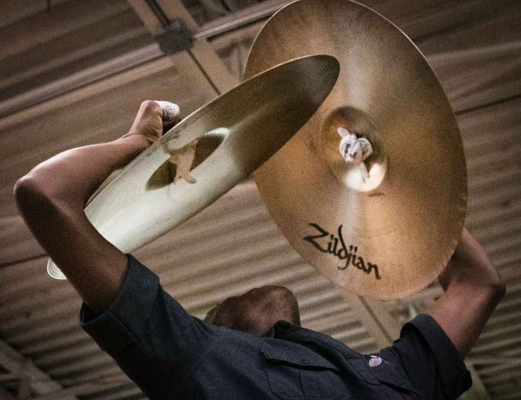 Darrquon Threlkeld, 18, practices the cymbals with  the Dallas Mass Band at the Braswell Child Development Center in Dallas on June 21.