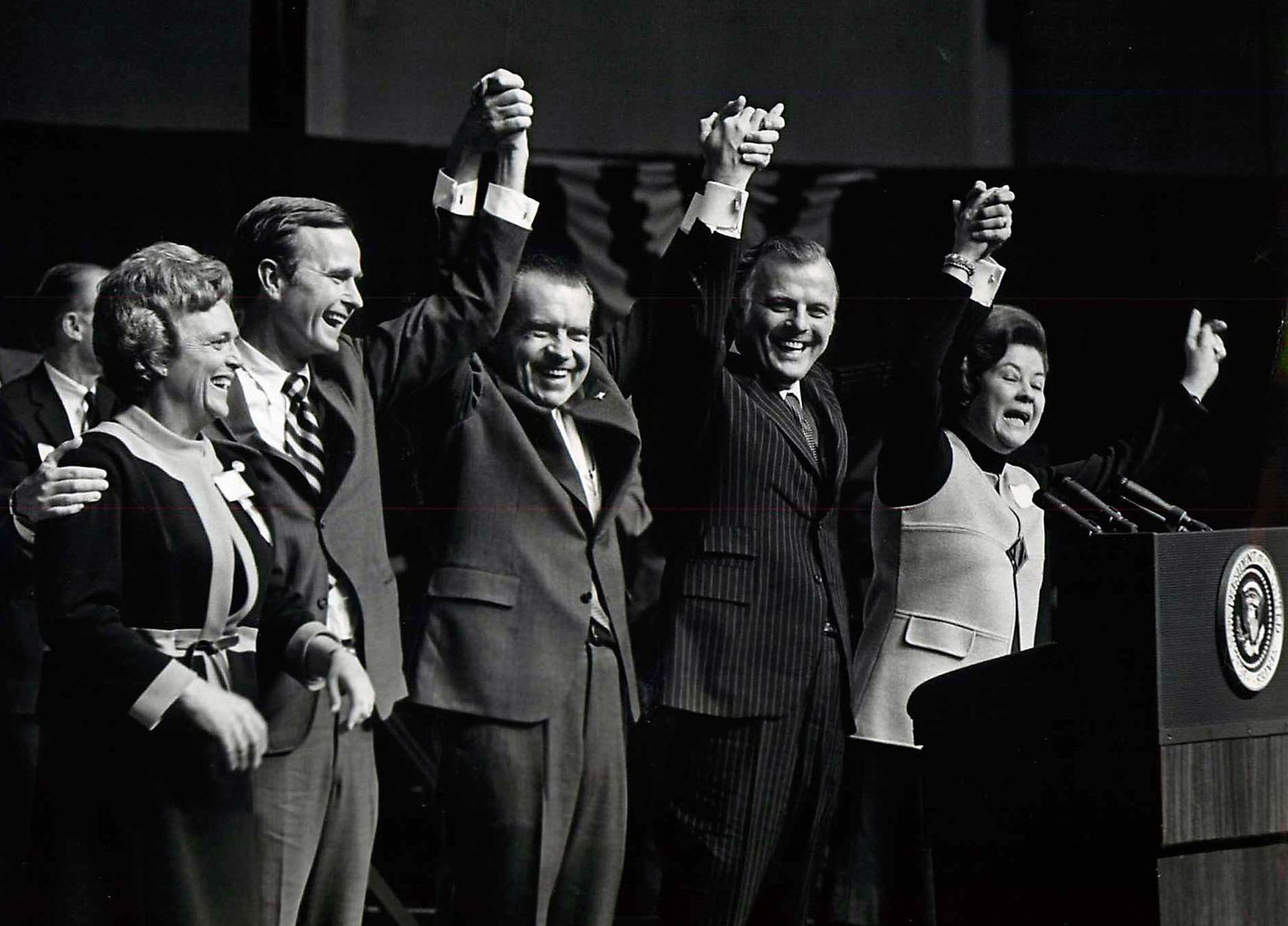 1970: President Richard M. Nixon speaks at a rally at Dallas Market Hall supporting George H.W. Bush (second from left) for U. S. Senate and Paul Eggers (second from right) for Texas governor. Barbara Bush is at far left.