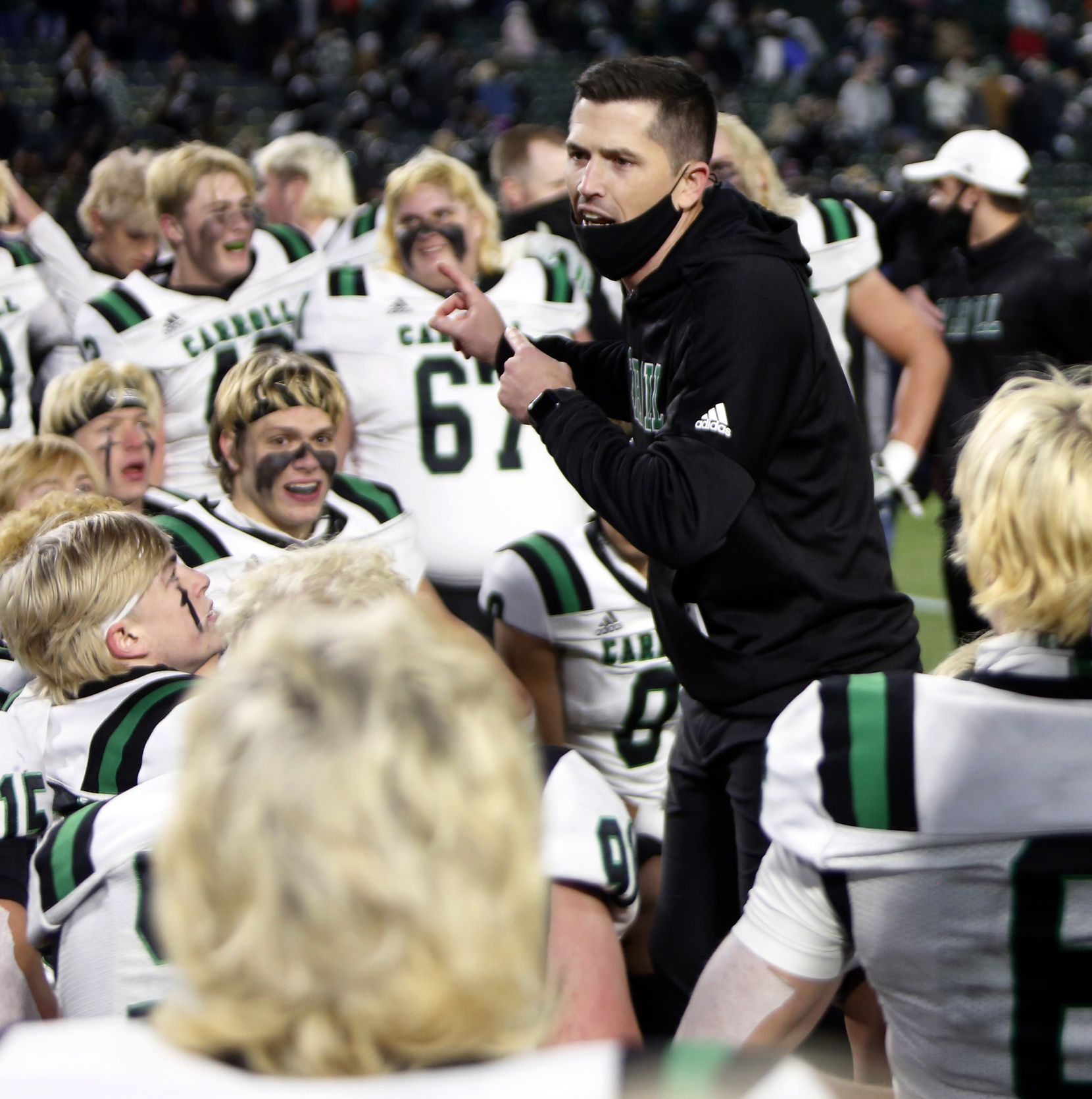 Southlake head coach Riley Dodge speaks with his players following their 30-26 victory over Arlington Martin to advance. The two teams played their Class 6A Division l Region l semifinal football playoff game held at Globe Life Park in Arlington on December 24, 2020. (Steve Hamm/ Special Contributor)