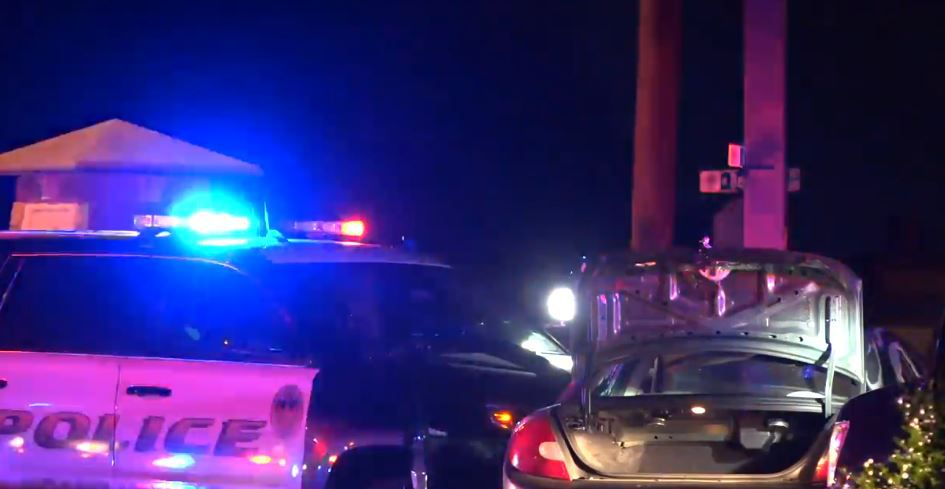 A Grand Prairie police vehicle lies against a car involved in a chase into Cedar Hill on Thursday night. The car's driver was shot and killed by a Grand Prairie officer after he waved a gun at officers.
