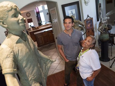 Bessie Rodriguez, far-right, mother of Santos Rodriguez, stands with sculptor Seth Vandable as Rodriguez views for the first time the form for the 6-foot statue will be dedicated for her son Santos Rodriguez, at Vandable's studio in Cedar Hill, on Tuesday, July 20, 2021. Santos was a 12-year-old boy killed by Dallas police officer 48 years ago.