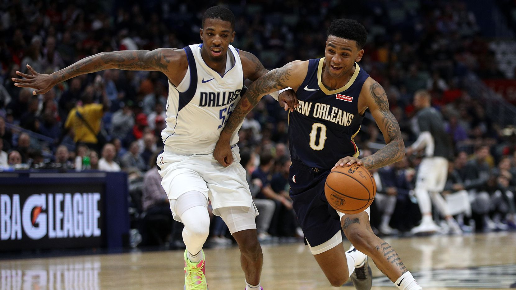 NEW ORLEANS, LOUISIANA - OCTOBER 25: Nickeil Alexander-Walker #0 of the New Orleans Pelicans drives the ball around Delon Wright #55 of the Dallas Mavericks at Smoothie King Center on October 25, 2019 in New Orleans, Louisiana. NOTE TO USER: User expressly acknowledges and agrees that, by downloading and or using this photograph, User is consenting to the terms and conditions of the Getty Images License Agreement.  (Photo by Chris Graythen/Getty Images)