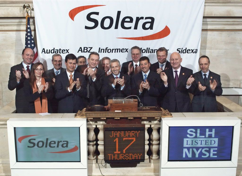 CEO Tony Aquila (center) and other officials celebrate Solera Holdings Inc. on its first day of public trading on Jan. 17, 2008.