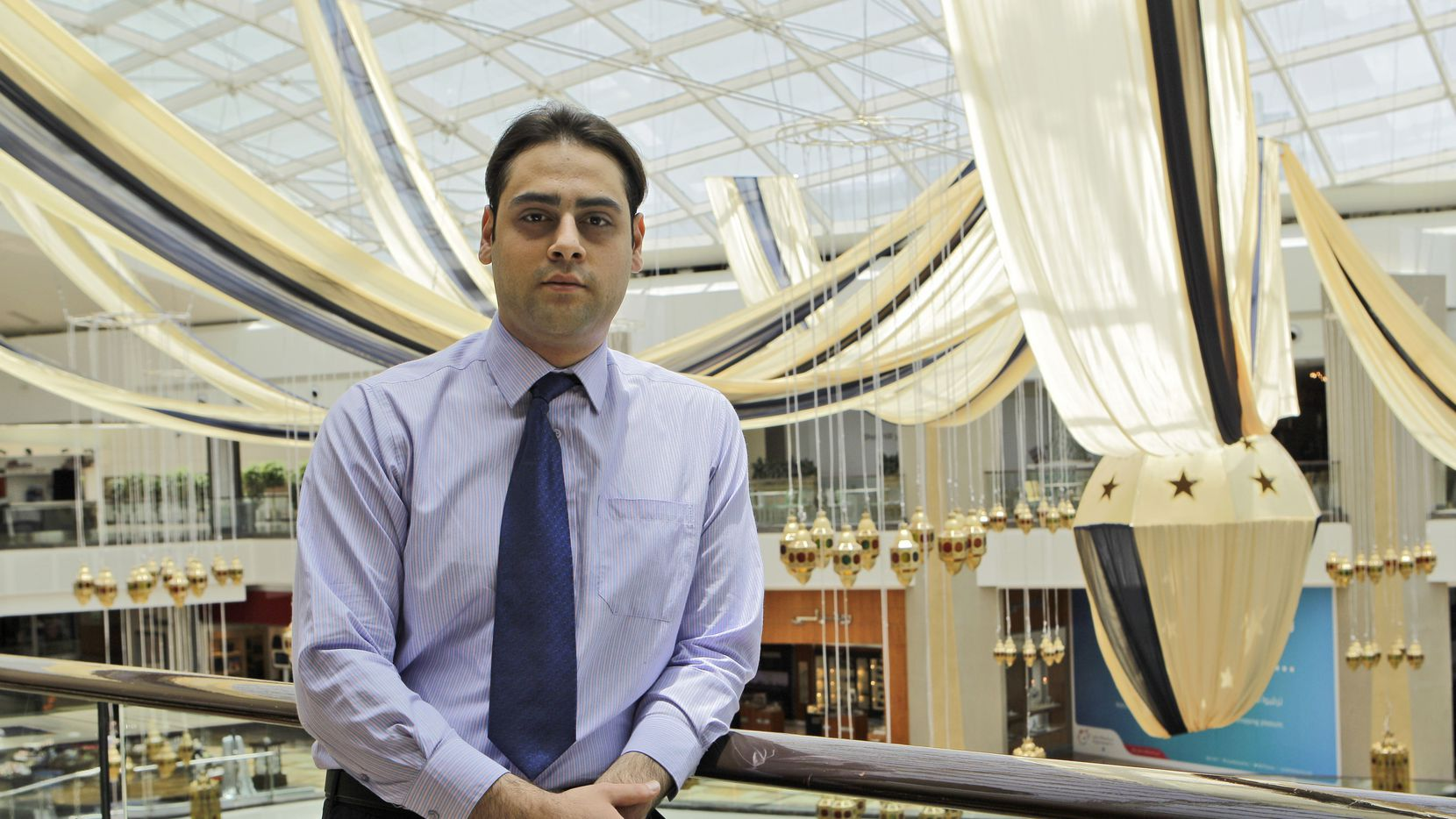 """Rafat Awad, a 23 year old pharmacist, poses for a portrait at a shopping mall in Dubai, United Arab Emirates on Wednesday, July 31, 2013. Describing his change of beliefs from Islam to atheism, """"It was the domino effect - you hit the first pin and it keeps on going and going,"""" said Awad, a Palestinian who grew up in the United Arab Emirates and lives there. """"I thought: It doesn't make sense anymore. I became a new person then."""" (AP Photo/Kamran Jebreili)"""