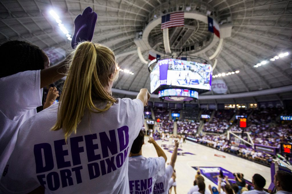 """TCU Horned Frogs students wear t-shirts that say """"Defend Fort Dixon,"""" which is a combination of Fort Worth and head coach Jamie Dixon. during the second half of an NIT quarterfinal game between TCU and University of Richmond on Tuesday, March 21, 2017 at the Ed & Rae Schollmaier Arena in Fort Worth. TCU won the game 86-68, and will continue to the next round of the tournament in New York City. (Ashley Landis/The Dallas Morning News)"""