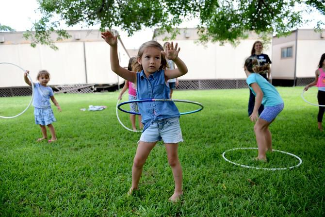 Evelina Kalenik, 5, Hula Hoops during summer camp at River of Life, an Evangelical Christian church that caters to Russian-speaking immigrants and operates out of Hunters Glen Baptist Church in Plano. River of Life is just one of six international churches meeting at Hunters Glen Baptist Church.