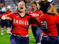 Allen's Taylor Wright (8) celebrates a two-run double by Celeste McCary during a four-run seventh inning in Allen's 8-2 win over Denton Guyer in a District 5-6A softball game Tuesday. (Juan Figueroa/The Dallas Morning News)