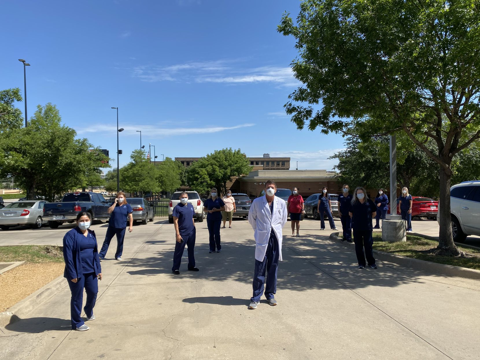 Cornea Associates of Texas workers gathered to watch the Blue Angels flyover in May. The team took a break to watch them fly right over its office.