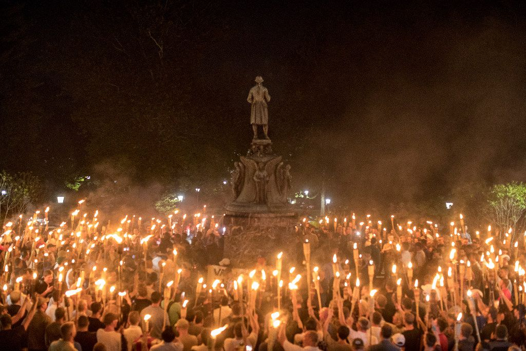 Torch-bearing white nationalists rally around a statue of Thomas Jefferson near the University of Virginia campus in Charlottesville, Aug. 11, 2017. Hi
