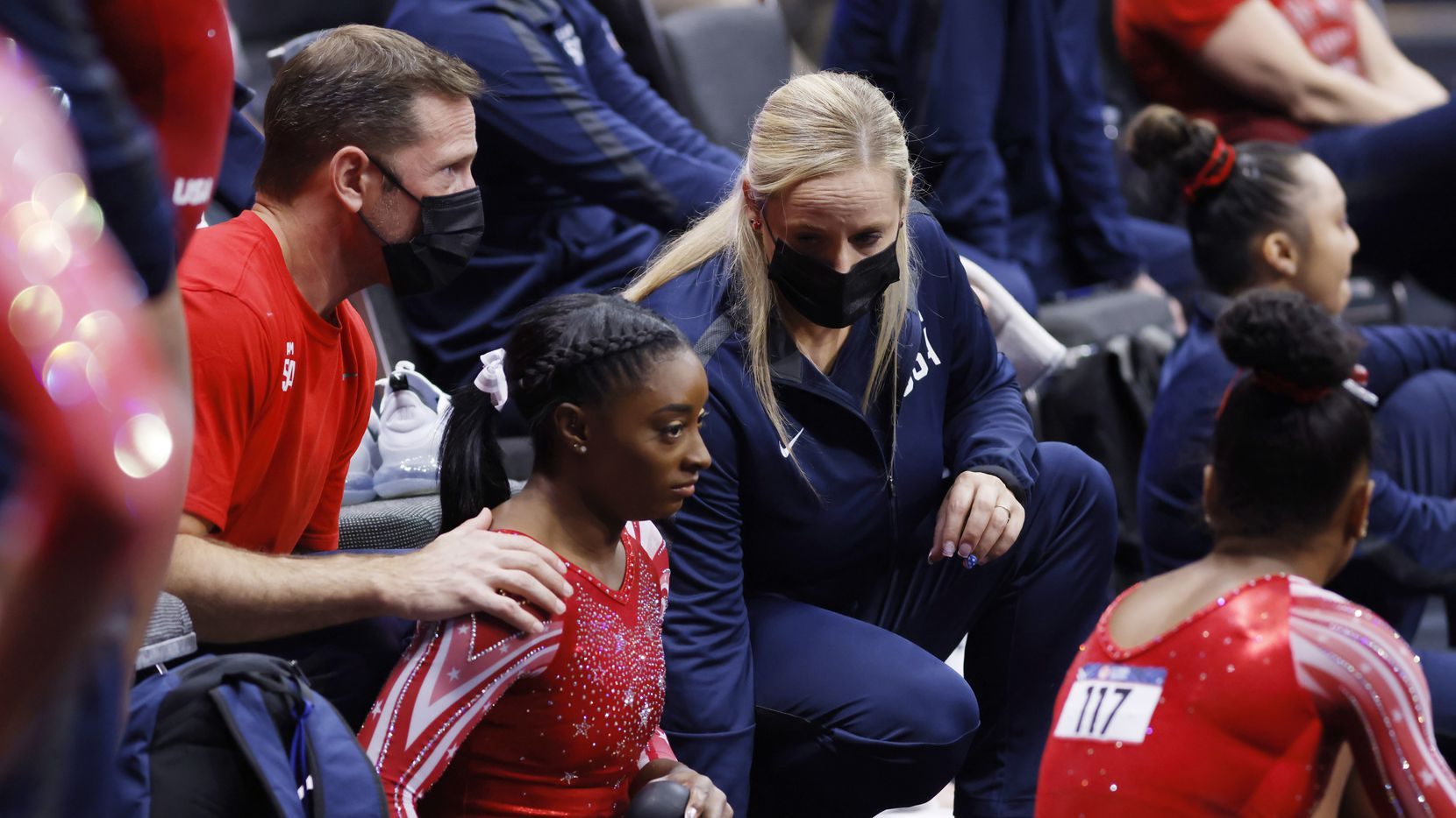 Coaches Laurent Landi (left) and Cecile Landi talk with Simone Biles after she competed on the balance beam during day 2 of the women's 2021 U.S. Olympic Trials at The Dome at America's Center on Sunday, June 27, 2021 in St Louis, Missouri.