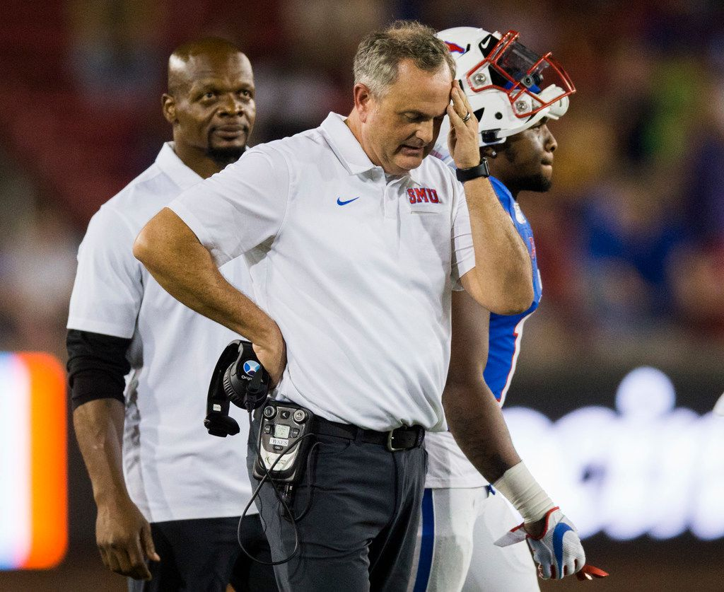 SMU Mustangs head coach Sonny Dykes puts his hand to his forehead during a timeout in double overtime of an NCAA football game between Tulsa and SMU on Saturday, October 5, 2019 at Ford Stadium on the SMU campus in Dallas. (Ashley Landis/The Dallas Morning News)
